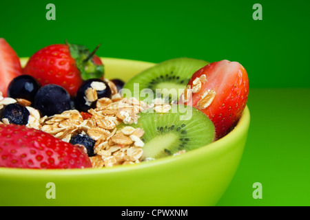 Bowl with muesli and fresh berries and fruits - Stock Photo