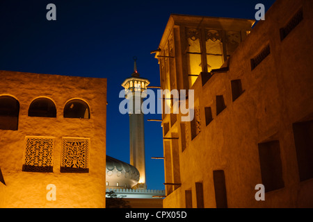 Night view of traditional Wind Houses in Bastakia Quarter, old town, Dubai, UAE - Stock Photo
