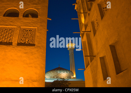 Night view of traditional Wind Houses and mosque in Bastakia Quarter, old town, Dubai, United Arab Emirates - Stock Photo