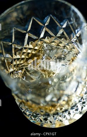 Whiskey on the rocks in a tumbler - Stock Photo