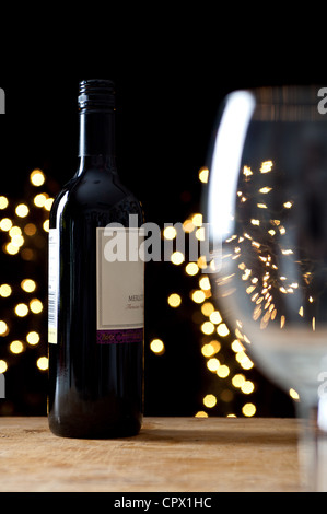 Bottle of red wine and empty glass - Stock Photo