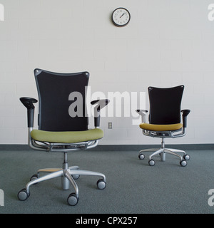 Empty office chairs in office - Stock Photo