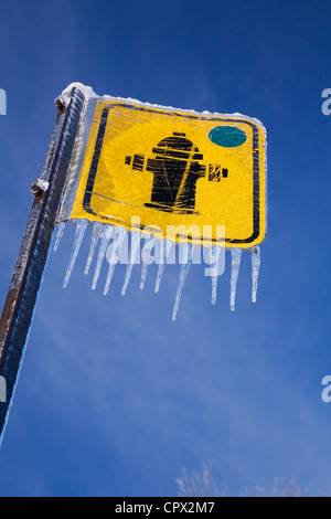 Fire hydrant sign and icicles - Stock Photo