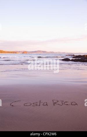 Costa Rica written in sand, Playa Grande, Santa Cruz, Costa Rica - Stock Photo