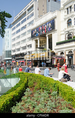 Leicester Square refurbished street amenities with Empire cinema and casino beyond - Stock Photo
