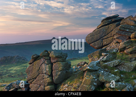 Hound Tor at dawn, with Hay Tor beyond, Dartmoor, Devon, England, UK - Stock Photo