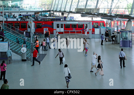 Interior Stratford London UK train station interchange concourse for Docklands Light Railway service at platform - Stock Photo