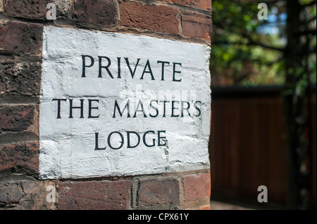 Sign painted on a wall at Jesus College Cambridge for the Masters lodge - Stock Photo