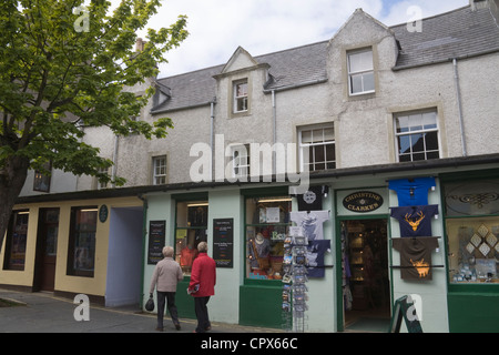 Kirkwall Orkney Islands Big Tree in pedestrianised Albert Street with independent shops in mainland capital town - Stock Photo