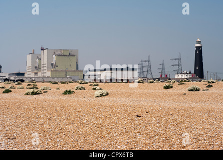 Dungeness Nuclear Power Station Kent Uk with The Old Lighthouse Seen Through Summer Heat Haze - Stock Photo