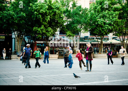 People walking in Nelson Mandela Square, Sandton, South Africa - Stock Photo