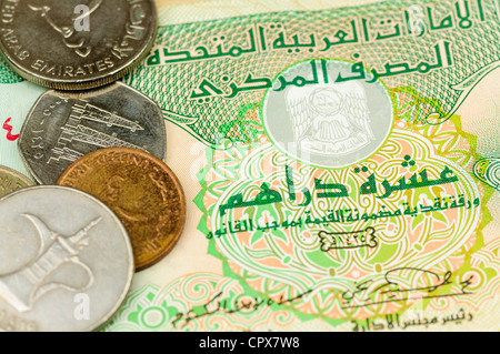 United Arab Emirates UAE dirhams bank note and coins - Stock Photo