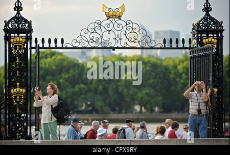 Tourists taking photos at the in front of the Water Gate of the Royal Naval College in Greenwich, London, England. - Stock Photo