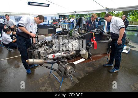 race technicians tinker with the car engines in the formula renault stock photo royalty free. Black Bedroom Furniture Sets. Home Design Ideas