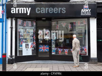 Man looking in window of Army Careers recruiting office, Abergavenny, Wales, UK - Stock Photo