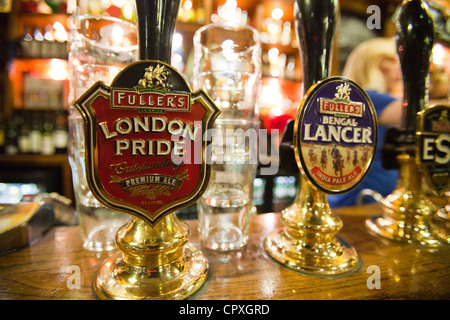 A real ale hand pump on the bar of the Euston Flyer, Kings Cross, London, UK. - Stock Photo