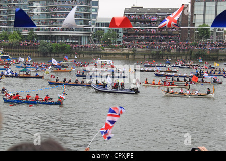 Man-powered flotilla of boats lead the Diamond Jubilee Thames Pageant, Battersea Bridge, London, UK, Sunday 3rd - Stock Photo