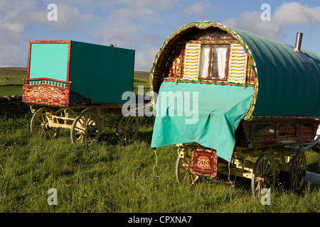 Gilded Carved and decorated Wagons and equipment belonging to travellers attending the annual Appleby horse fair, - Stock Photo