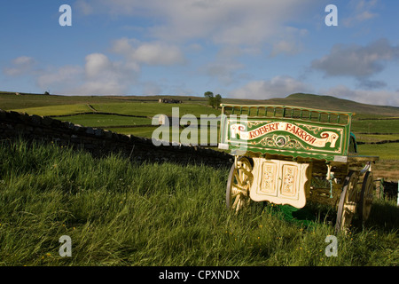 Robert Farrow Wagons and equipment belonging to travelers attending the annual Appleby horse fair, Cumbria Uk - Stock Photo