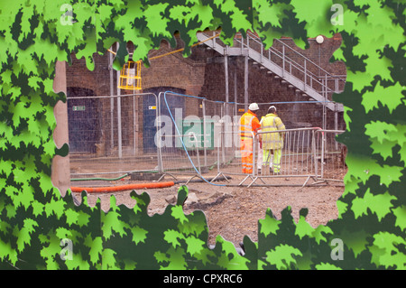 Urban renwal works at Kings cross, London, cleaning up groundworks where the old gasometers used to stand - Stock Photo