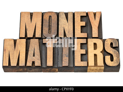 money matters - financial concept - isolated text in vintage letterpress wood type - Stock Photo