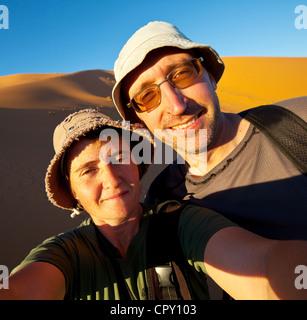 couple in hike in Namib desert - Stock Photo
