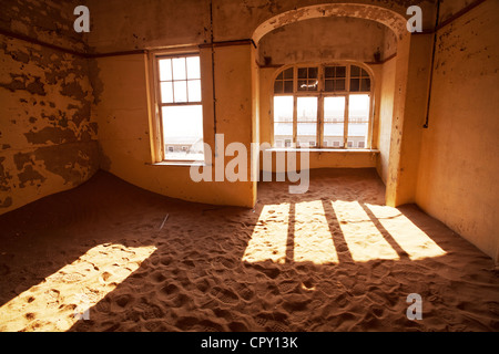 Ruins of abandoned houses in the ghost diamond town Kolmanskop, Namibia, Africa - Stock Photo