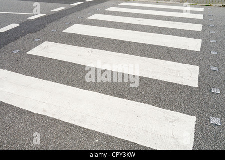 British zebra crossing white stripes on road close up. - Stock Photo