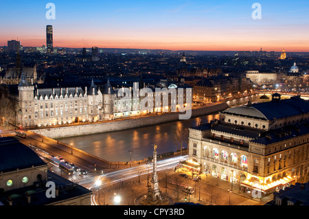 France Paris general view sunset with Conciergerie Châtelet square theatre on right banks of Seine listed as Word - Stock Photo