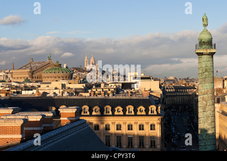 France, Paris, the column of Vendome square from the roofs with the Sacré-Coeur and Garnier opera house in the background - Stock Photo