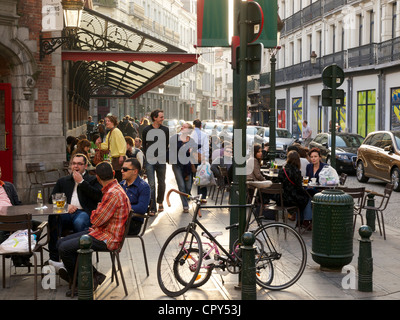 People having a drink and sitting outside at a Brussels cafe, Belgium - Stock Photo