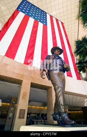 A larger-than-life statue honors famous film star John Wayne at John Wayne Airport in Santa Ana, Orange County, - Stock Photo