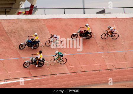 Women Cyclists in velodrome race on track outdoor in Palma de mallorca sport festival - Stock Photo
