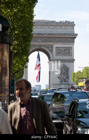 the Arc de Triomphe in Paris as viewed from the champs elysees - Stock Photo