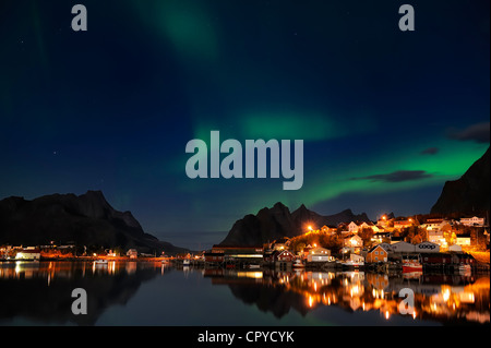 Norway, Nordland County, Lofoten Islands, Moskenes Island, aurora borealis over Reine fishermen village - Stock Photo