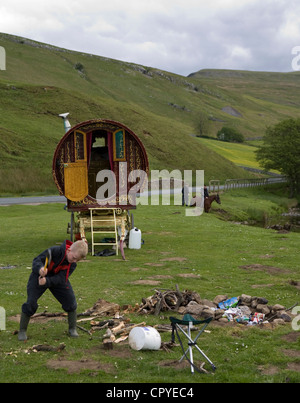 Travellers assembling for the Appleby Horse Fair  Bow top traditional caravans and horse-drawn carriages and wagons. - Stock Photo