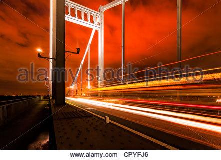 Rhine bridge Krefeld Uerdingen traffic road night light traces steel construction building structure travel Ruhr - Stock Photo