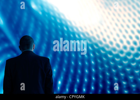 Look into future technology background blue with man - Stock Photo