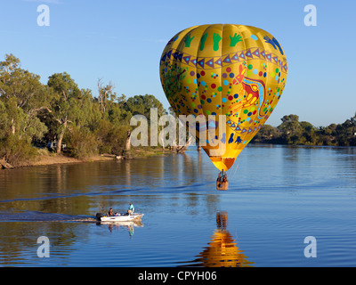 Colorful balloon drifts slowly over the River Murray near Wentworth, NSW, Australia - Stock Photo