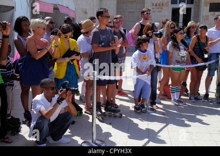 Miami Beach Florida Collins Park Evian Water Live Young Skate On! bottled product promotion event Black woman man - Stock Photo