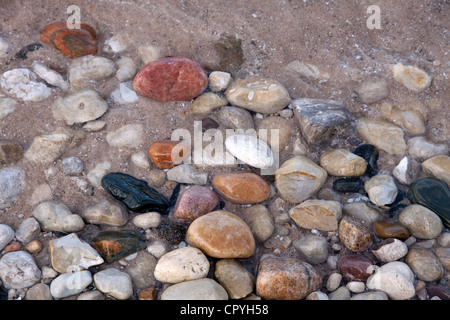 Various eroded stones, agates, and pebbles on shore of Lake Huron Michigan USA - Stock Photo