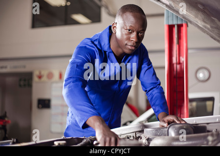 African man working on a car engine - Stock Photo