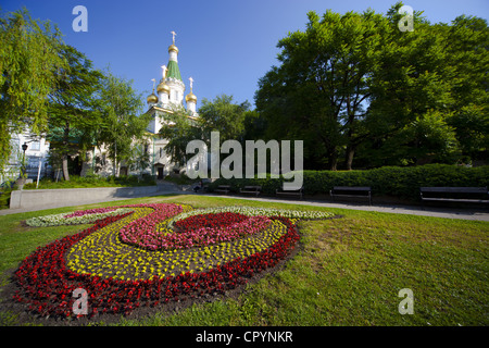 Flower bed in gardens with Church of St. Nicholas the Miracle Maker, behind, Boulevard Tsar Osvoboditel, Sofia, - Stock Photo