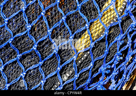 Close up detail shot of fishing nets at Pittenweem harbour, Scotland. - Stock Photo