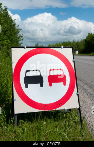 no overtaking warning sign due to loose chippings on newly resurfaced road uk - Stock Photo
