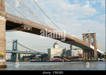 Brooklyn Bridge, a suspension bridge spanning the East River, with the Manhattan Bridge at the rear, Two Bridges - Stock Photo