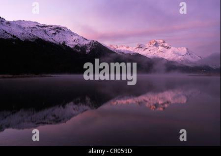 Early morning on Lake Silvaplana, Mt Piz da la Margna at back, St. Moritz, Engadine, Grisons, Switzerland, Europe - Stock Photo