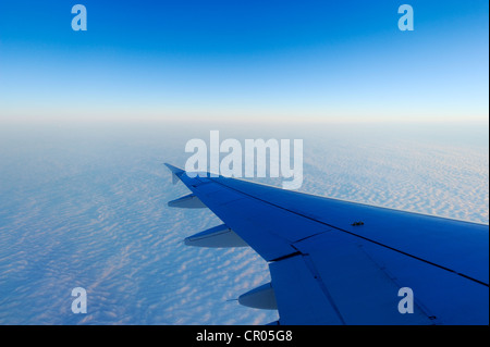 Airplane wings over a sea of fog, Basel, Switzerland, Europe - Stock Photo