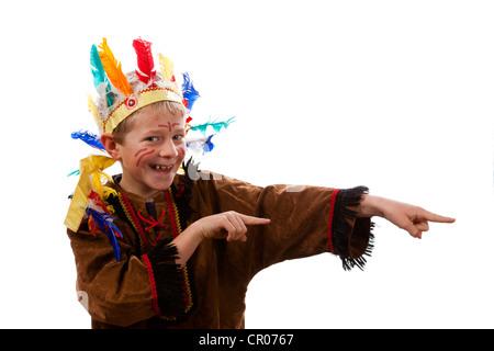 A boy, 7 years, wearing American Indian fancy dress - Stock Photo