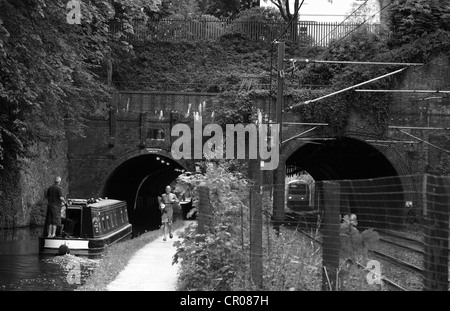 a view of a bridge with two arches - one crossing a railway and the other crossing a canal in Birmingham - Stock Photo